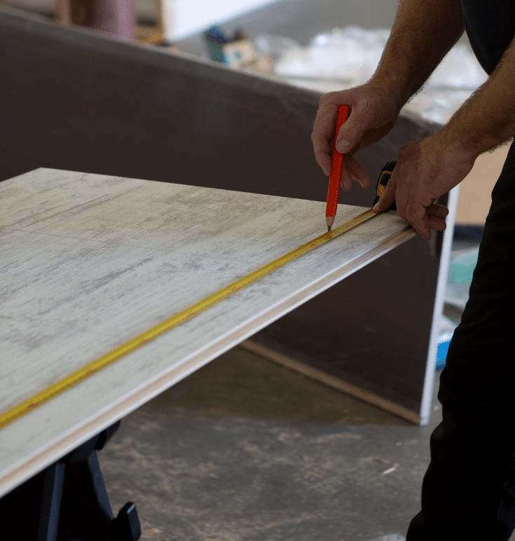 Shooting videos of laminate shower wall panels being cut | Innovate Builders Blog | #LaminateWallPanels #BuildersVideo #InstallationVideos #InstallationTips #MarketingTactics