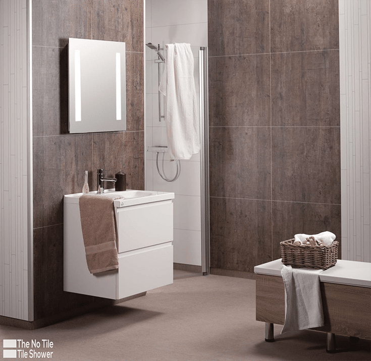 updated bathroom with laminate grout free shower wall panels   Innovate Building Solutions   Innovate Builders Blog   #BathroomRemodel #Laminatewallpanels #GroutFreePanels