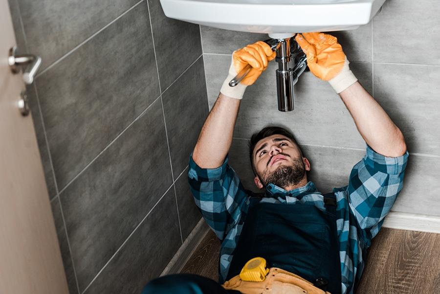 contractor repairing a leak smaller jobs | Innovate Building Solutions | innovate builders blog | #Contractor #RepairSink #plumbingrepair