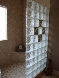 mosaic tile floor on the shower with larger tile interior walls