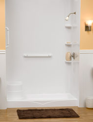 shower pan with an integral bench seat and safety grab bar in a white color