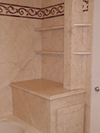 towel storage area and tub wall panels using the Sentrel botticino cream stone pattern