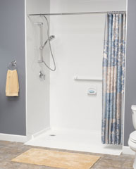 accessible shower design with a curved shower rod and handheld showerhead