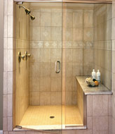 shower benchseat with a frameless shower door system