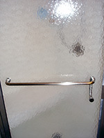 Pull handle and towel bar on obscure door