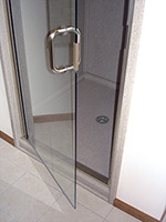 6 inch pull handle on both sides of a frameless clear glass door