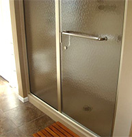 Pull handle towel bar on a sliding glass door