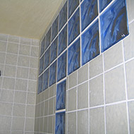Blue blocks in shower wall