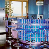 Glass block bar with blue colored decora pattern glass blocks in a 4in x 8in size in a rounded radius design in New York City.