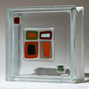 artist developed glass tiles applied to a glass block