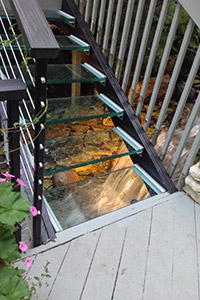 Glass stairs over water