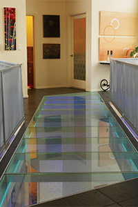 Glass floor bridge over stair landing
