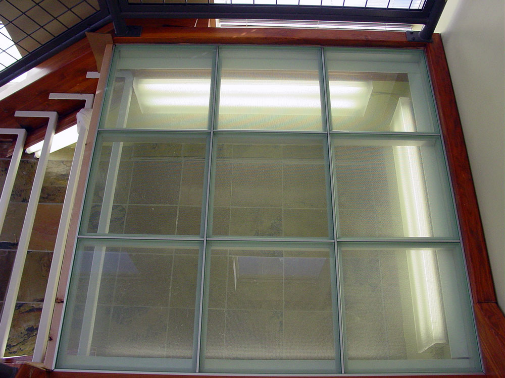 Glass floor panels stair treads for bridge landings for Glass block floor