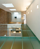 structural glass floor system and deck in a residential home
