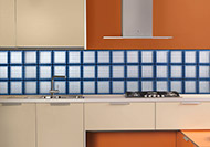 Glass blocks in a backsplash using mosaic tiles on the units
