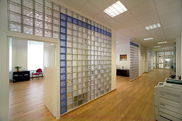 blue clear and frosted glass blocks in a office building with finished end blocks