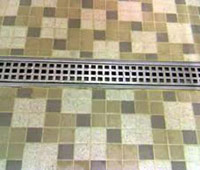 linear trench drain for a tile floor