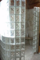 tile shower with a no barrier entrance with glass block walls