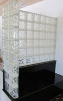 glass block half wall on a granite bench seat