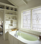 Designer soaker tub windows with decorative glass