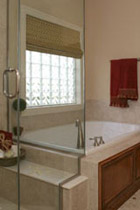 Bathroom privacy window above a soak tub