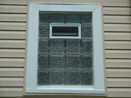 Glass block bath window with coil stock on the outside replaced an old double hung window