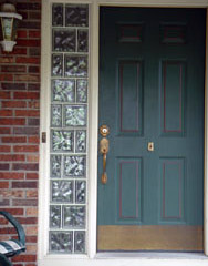 Glass block sidelights around a front door