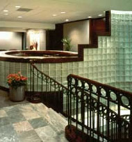 step down design glass block wall in a reception area