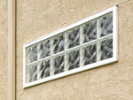 vinyl framed glass block window in a stucco wall