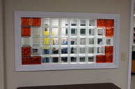 interior window in a commercial building using clear & colored glass blocks