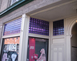purple storefront glass in athens ohio