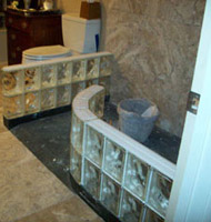 premade glass block shower walls during the construction process