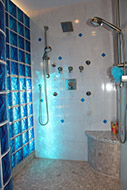Curved blue glass block wall