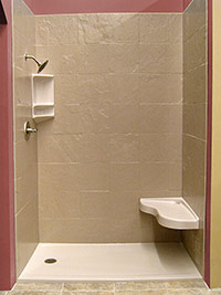 Low profile curb solid shower base with solid surface tile pattern walls