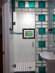 Small colored glass block shower wall