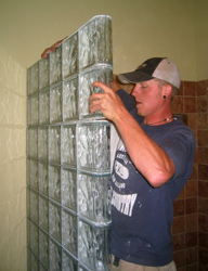 thinner series glass block shower wall being installed by a DIY