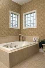 vinyl framed glass block windows above a soaking tub