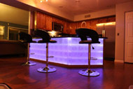 colored lighting behind a kitchen island