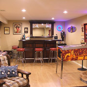 Man cave with a wet bar and pinball machine in cleveland ohio