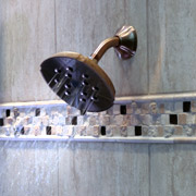wall mounted shower head in a tile shower in cleveland