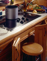 Smooth cooktop with roll out stool makes it easy to move hot items off the stove