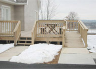 Outdoor deck and ramp combination for handicap entrance