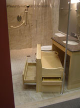 Custom accessible lifetime vanity with glide out cabinets, support bar, roll under sink
