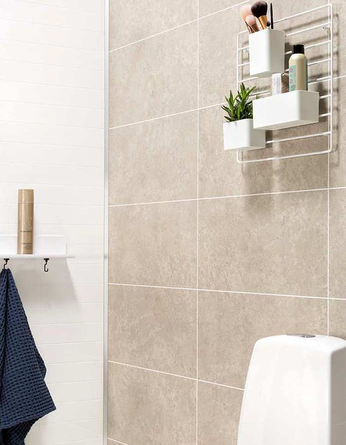 Laminate bathroom wall panels give a real tile or stone look without grout maintenance