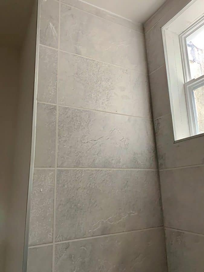 Textured shower wall panels affordable single family rental home philly | Innovate Building Solutions | Multi Tenant Housing | #TexturedShowerPanels #AffordableRentals #SingleFamilyRentals