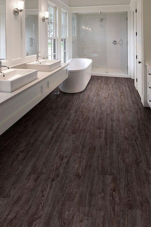 Luxury vinyl bathroom flooring image source Flooring America.com   Innovate Building Solutions   Luxury Rentals   #Flooringbathroom #ShowerRemodel #bathroomRemodel #HotelRemodel