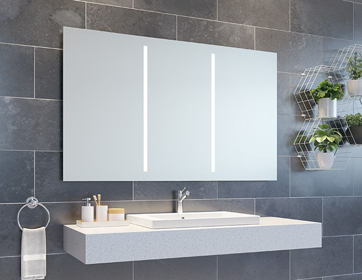 Mirrored medicine cabinet more storage better lighting vacation home rental bathroom   Innovate Building Solutions    Luxury Apartments   #LuxuryRentals #ApartmentRentals #BathroomMirror #LEDMIrror