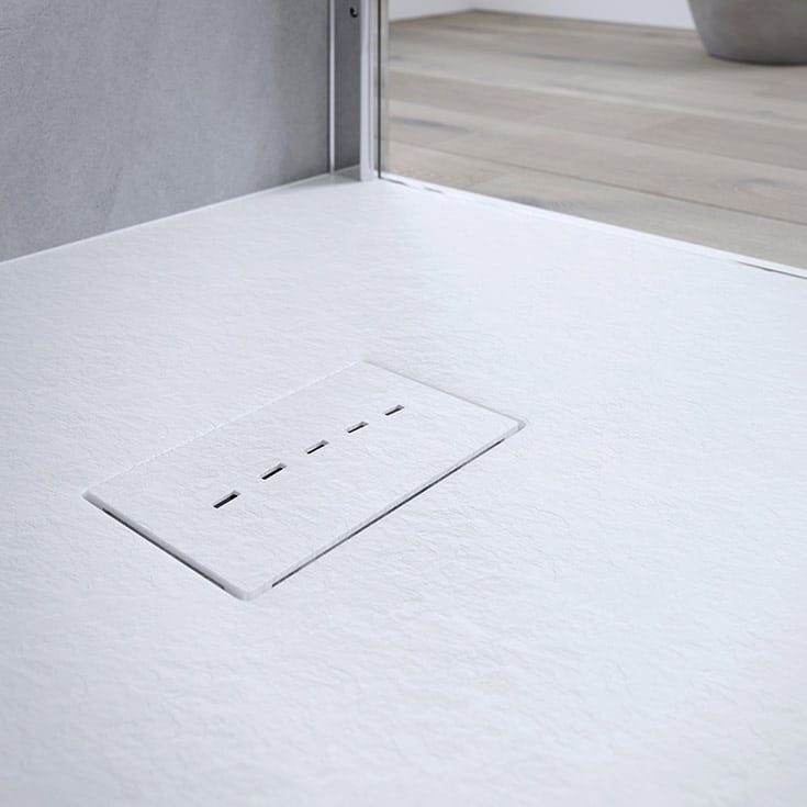 one level matte white shower pan | Innovate Building Solutions | Student Housing | Senior Living | Senior Housing | #LinearDrain #ShowerDrain #BathroomForElderly