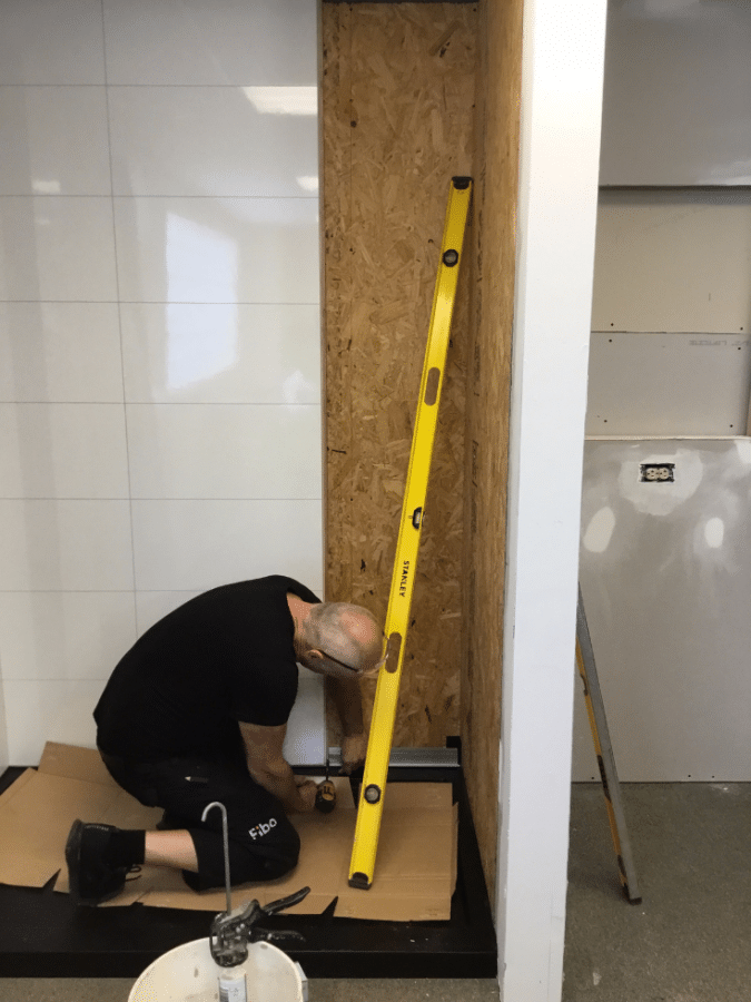 Laminate shower panels being installed in a modular home   Innovate Building Solutions   Multi Unit   Modular Homes   #LaminateWallPanels #ShowerWallPanels #ModularHomes