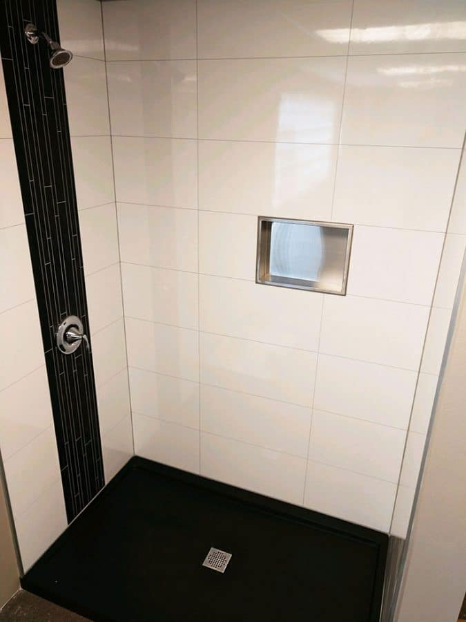 Laminate shower wall panels for a modular offsite built home | Innovate Building Solutions | Innovate Multi Unit  | #Laminatewallpanels #Showerwallpanels #ModularHomeBathrooms #OffsiteBuiltHome